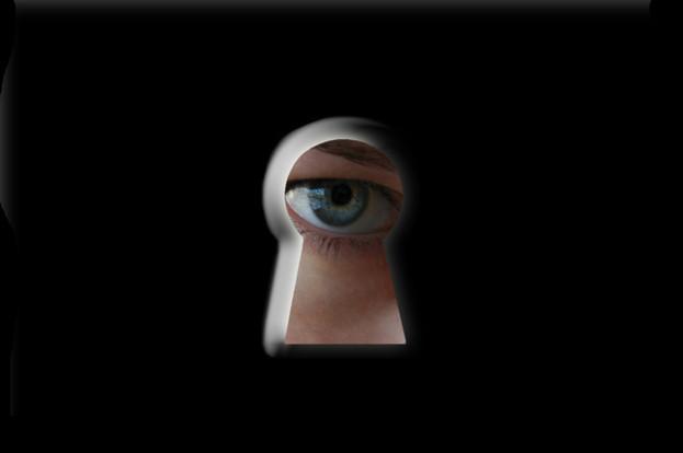 To peep through a keyhole