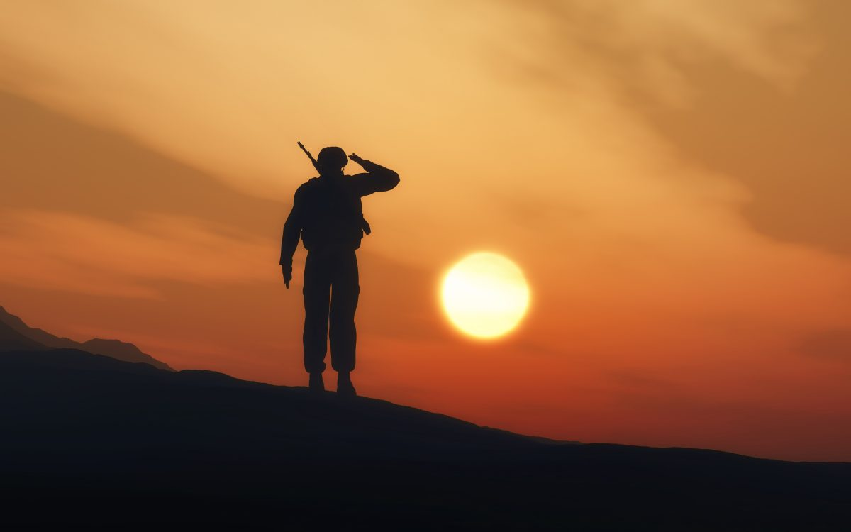 3D render of a silhouette of a soldier saluting against a sunset sky